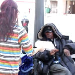 slide-woman-giving-food-to-homeless-man-vme